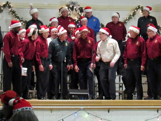 The Capital Chordsmen serenade concert attendees with holiday harmony.