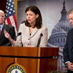 FILE - In this Jan. 13, 2015, file photo, Sen. Kelly Ayotte, R-N.H., center, flanked by Senate Armed Services Committee Chairman Sen. John McCain, R-Ariz., left, and and Sen. Lindsey Graham, R-S.C., speaks during a news conference on Capitol Hill in Washington, Tuesday, Jan. 13, 2015. Republicans now in charge in Congress offer their budget blueprint the week of March 16 with the pledge to balance the nation's budget within a decade and rein in major programs such as food stamps and Medicare.  More pressing for many Republicans, however, is easing automatic budget cuts set to slam the military.
