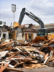 A heavy equipment operator uses an excavator to demolish the McDonalds restaurant located at Holliday and 15th Street Tuesday. The fast food franchise will reopen in late September with a larger, more efficient building.