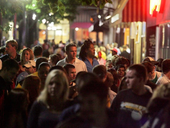 People fill the pedestrian mall in downtown Iowa City