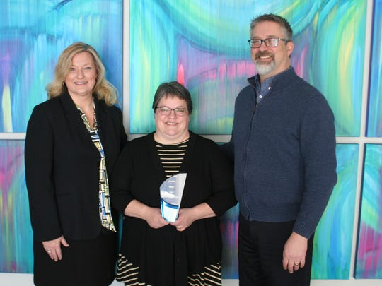 2016 Best New Downtown Business Award Winners from left: Amy Hansen, DFP executive director; Ann Culver, owner of Annie's Fountain City Café; and Alan Hathaway, DFP Board president.