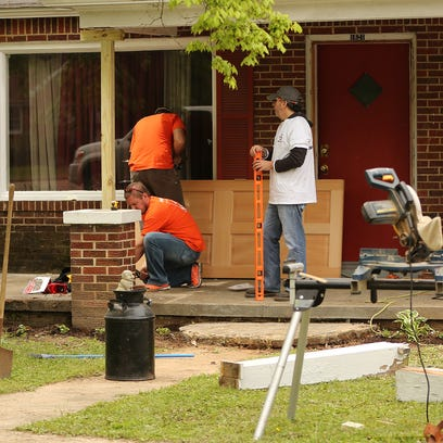 Members of Team Depot from Home Depot make repairs