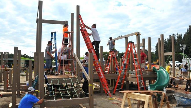 Hundreds of volunteers donated their time to build a playground for children with special needs at the Field of Dreams sports complex.