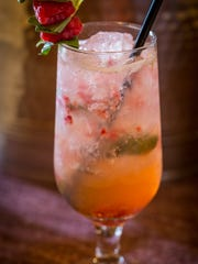 Bourbon Raspberry Spritzer with basil and prosecco, a new craft cocktail served at Morris Tap & Grill.
