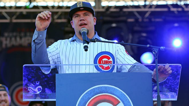 Chicago Cubs designated hitter Kyle Schwarber (12) talks during the World Series victory rally in Grant Park on Nov. 4, 2016.
