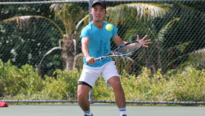 Guam's Derek Okuhama returns a serve by Japan's Soma Yokoyama during a Round 1 match of the Chuck E. Cheese's ITF Junior Championships boys main draw Monday at the Rick Ninete Tennis Center in Hagåtña. Yokoyama won 6-2, 6-2.