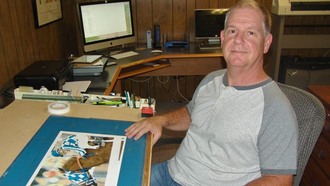 Frank Pettibone, a Coshocton native, poses with his drawing of Secretariat.