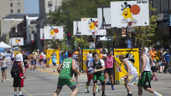 Sets of hoops took over a portion of Main Street downtown Oshkosh for the annual Gus Macker basketball tournament on Saturday, August 15, 2015.