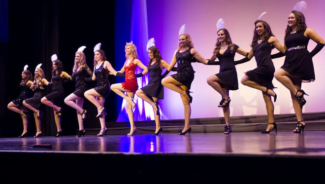 Ten contestants with Miss Oshkosh MeKenzie Lund perform the opening dance for the show of the Miss Oshkosh Scholarship Pageant at the Alberta Kimball Auditorium on Saturday, March 12, 2016.