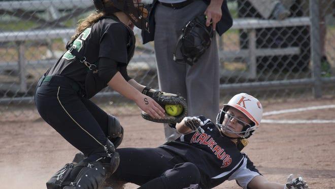 Oshkosh North catcher Sammy Buerger tags out Kaukauna's Brianna Braeger in the first inning of Thursday's Fox Valley Association showdown in Oshkosh.