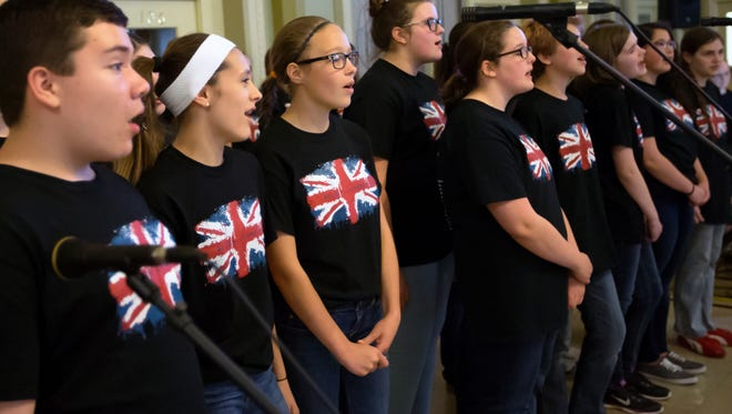 The Oshkosh Youth Choir put on a performance inside the National Bank building during the May 7, 2016 Gallery Walk.