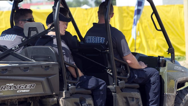 Winnebago County Sheriff officers monitor the hangout area during Country USA on Saturday.