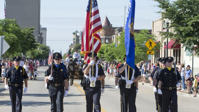 The City of Oshkosh Police Color Guard marched down Main Street in the Oshkosh Fourth of July parade.