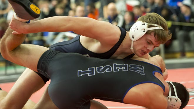Random Lake's Helton Vandenbush controls Oshkosh West's Reed Yoder in a 170-pound semifinal at the On The Water Classic on Friday.