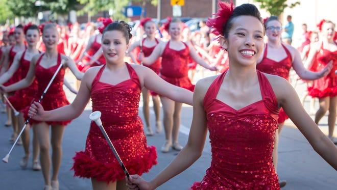 Julie's Touch of Silver twirlers perform in the Oshkosh Fourth of July parade.