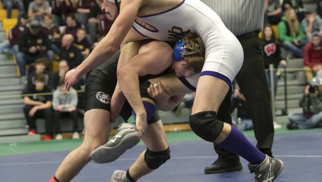 Random Lake's Grayson Vandenbush takes down Dillon Martin of Wautoma/Wild Rose during the Oshkosh Lourdes wrestling tournament Dec. 30. Vandenbush is 21-1.