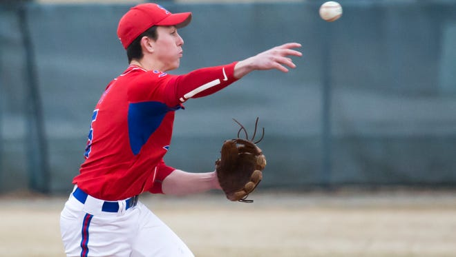 Hortonville's Grant Mullins throws to first against Oshkosh North during a Fox Valley Association baseball game Thursday in Oshkosh.