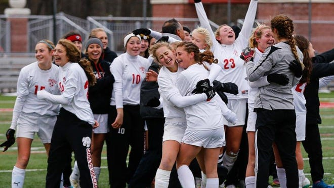 Somers players exult after defeating Rockville Centre South Side 3-1 in the state Class A championship girls soccer game at SUNY Cortland on Sunday.