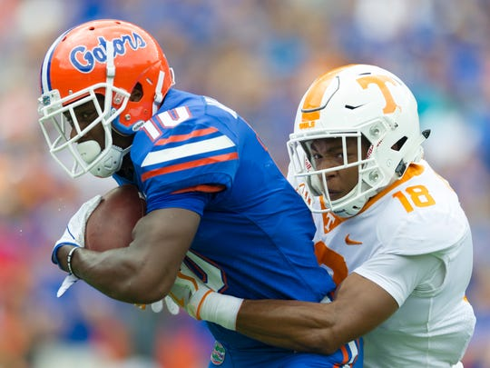 Tennessee defensive back Nigel Warrior (18) takes down Florida wide receiver Josh Hammond (10) during the Tennessee Volunteers vs. Florida Gators game at Ben Hill Griffin Stadium in Gainesville, Florida on Saturday, September 16, 2017.