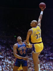 Kareem Abdul-Jabbar, shoots over Rick Mahorn in 1989.