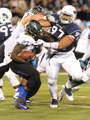 Wolf Pack defensive lineman Salesa Faraimo, shown during a game in 2014, is out for the season with a torn pectoral.
