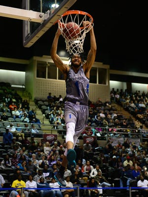 A player lays down a dunk in the 2016 Governor's Challenge Slam Dunk contest.