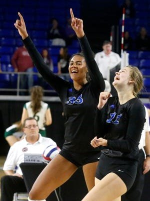 Brentwood's Logan Eggleston (33) and Celia Lamb (11) celebrate a point during the TSSAA Class AAA State Girls' Volleyball Tournament against Siegel, on Wednesday, Oct. 18, 2017, at MTSU.