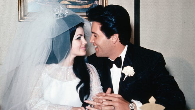 """In this May 1, 1967, file photo, singer Elvis Presley and his bride, the former Priscilla Beaulieu, appear at the Aladdin Hotel in Las Vegas, after their wedding. Priscilla Presley opened up about her life with Elvis during a Nov. 16, 2016, interview on British chat show, """"Loose Women,"""" on the ITV network explained why she left him."""