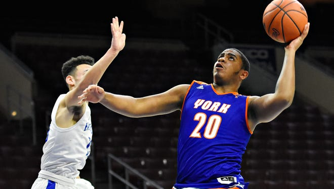 York High's Marquise McClean, right, takes the ball to the hoop while Cedar Crest defends during Court of Dreams game action at Wells Fargo Center in Philadelphia, Friday, Dec. 15, 2017. York High would win the game 55-48. Dawn J. Sagert photo