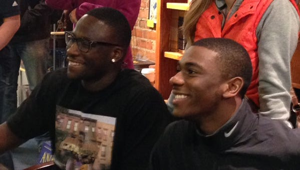 Devin Gardner and Devin Funchess smile for the cameras during an autograph session Saturday in Ann Arbor.