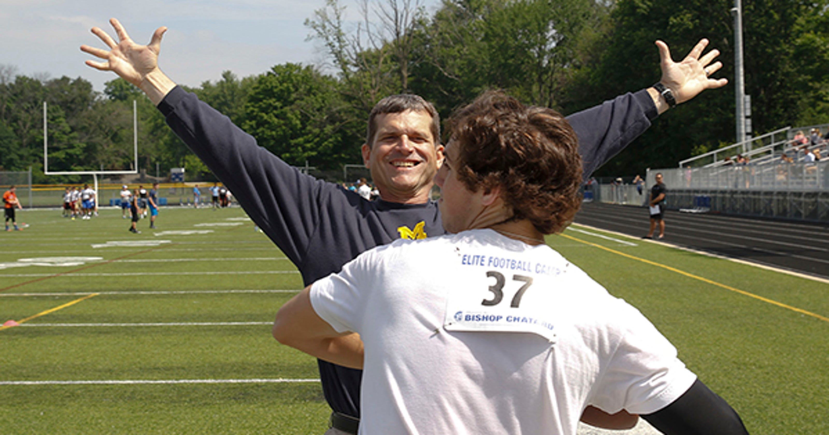 save off f3997 dbadf  Energetic  Harbaugh puts Indy campers through their paces