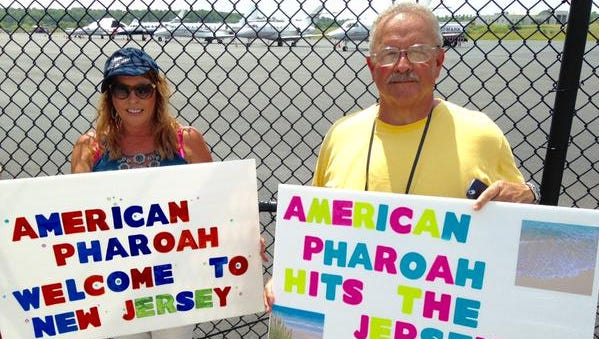 Lisa Cannon of Mays Landing and Tony Conte of Strathmere wait for American Pharoah on Wednesday in Atlantic City.