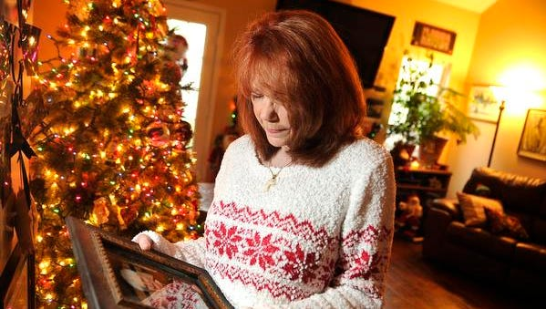 Judy Hunt Charest looks at a photo of her mother,  Marguerite Hunt Schultz, who died in March at age 86. When Charest was 3 months old, her mother, who was battling bipolar and postpartum depression, jumped off the Shelby Street Bridge on Christmas Eve with her in her arms. They both were rescued.