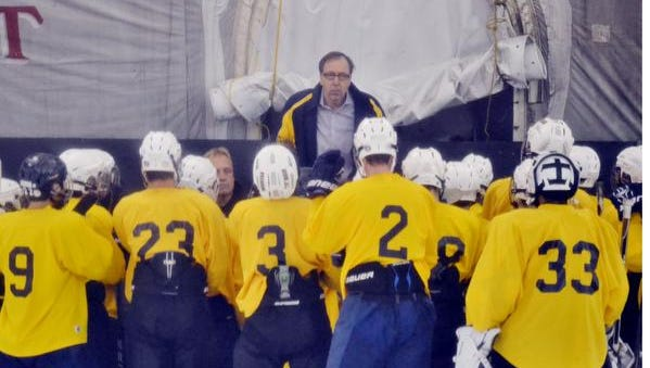 Pelham ice hockey coach Ed Witz talks with his team Monday after finishing the first practice of the season at the Ice Hutch in Mount Vernon. The Pelicans are the defending Section 1 Division II champions.