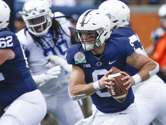 Jan 1, 2019; Orlando, FL, USA; Penn State Nittany Lions quarterback Trace McSorley (9) runs with the ball during the first quarter against the Kentucky Wildcats in the 2019 Citrus Bowl at Camping World Stadium. Mandatory Credit: Reinhold Matay-USA TODAY Sports