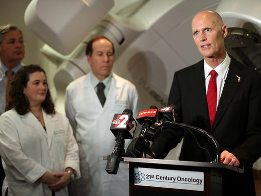"""Dania Maxwell/Staff Governor Rick Scott speaks at a press conference about cancer research funding in the """"It's Your Money Tax Cut Budget,"""" at 21st Century Oncology on Thursday, April 10, 2014 in Fort Myers, Fla. Scott has increased funding for state cancer research centers by $30 million."""