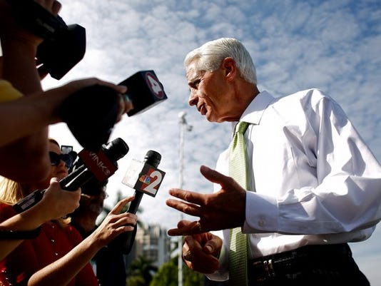 Scott McIntyre/Staff Former Gov. Charlie Crist speaks with members of the media outside of LaCiel Venetian Towers where he would later talk with the Naples Women's Forum on Monday March 7, 2014.
