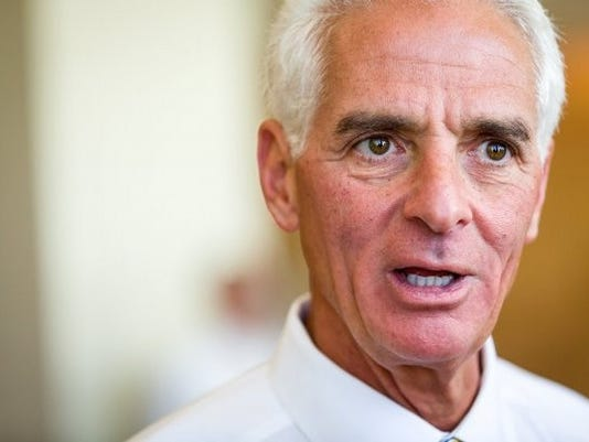 Charlie Crist speaks to the media while appearing at the 70th annual convention of the Florida Professional Firefighters at the Waldorf Astoria Naples on Friday, June 6, 2014, in Naples. Crist received an endorsement and a $100,000 campaign donation from the firefighter organization at the event. (David Albers/Staff)