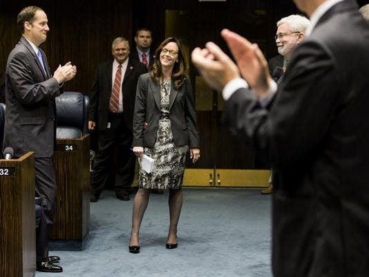 Sen. Lizbeth Benacquisto, R-Fort Myers, center, receives a standing ovation from her Senate colleagues upon her return to the Senate April 23, 2014 at the Capitol in Tallahassee. Benacquisto had taken time away from Tallahassee to compete for the congressional seat vacated by Trey Radel, R-Fort Myers. She placed second in the four-way republican primary, losing to Curt Clawson who will face Democrat April Freeman, Libertarian Party of Florida candidate Ray Netherwood and write-in candidate Timothy Rossano in the June 24 special general election. COLIN HACKLEY PHOTO
