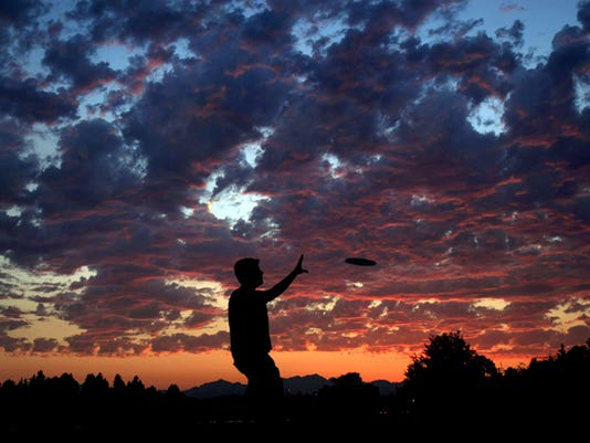 Colin Potter of Bremerton plays frisbee at Lions Park in Bremerton on Sunday at sunset. (LARRY STEAGALL / KITSAP SUN)