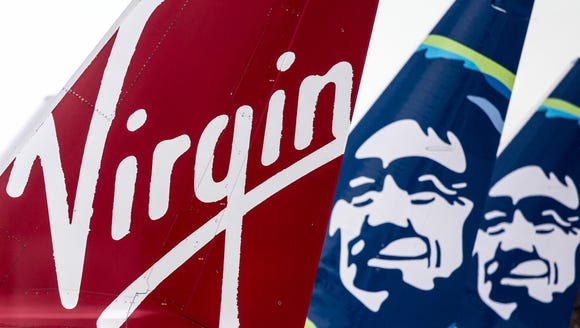 Virgin America and Alaska Airlines tails mingle togther