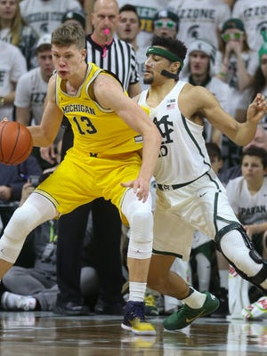 Michigan State forward Kenny Goins defends Michigan forward Moritz Wagner in the second half Sunday, Jan. 29, 2017 at the Breslin Center in East Lansing.