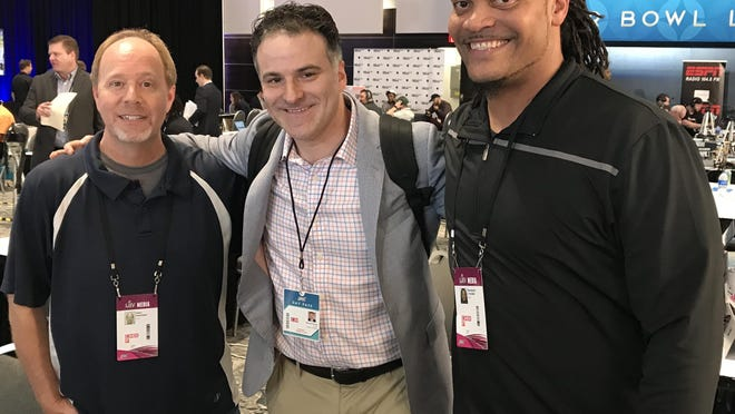 Former Miami Dolphins linebacker Channing Crowder, right, and sports business analyst Darren Rovell, center, were among those on Radio Row this week at the Miami Beach Convention Center.