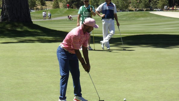 Lions wide receiver Golden Tate putts at the American