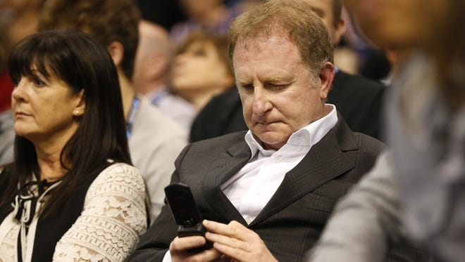 Phoenix Suns owner Robert Sarver uses his phone during the third quarter against the Sacramento Kings at Talking Stick Resort Arena October 23, 2017.
