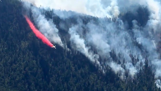 An aircraft drops retardant over the Taylor Creek Fire in Southern Oregon.