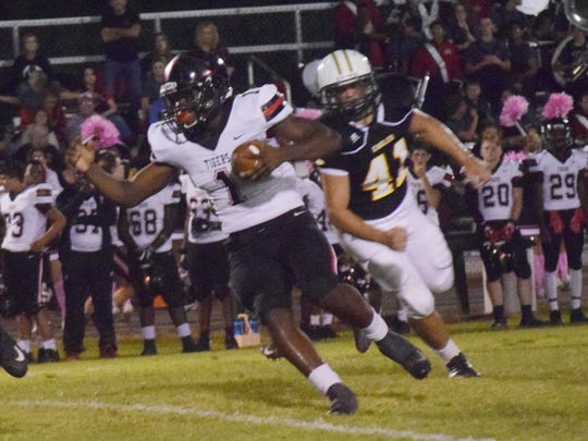 Many running back Terrence Williams picks up a first down against Menard in Week 7 last season.