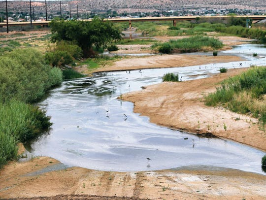The Rio Grande flows between West Paisano Drive and