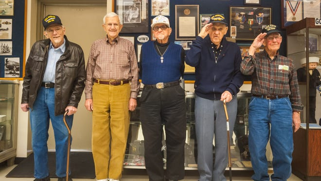 World War II Navy veterans Ed Turner, Dick Young, Bob Westcott, Owen Garrison and Jack Williams pose for a photo at the Millville Army Air Field Museum on Friday, December 29.