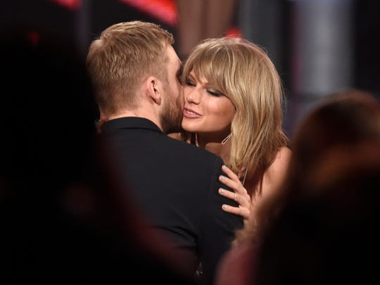 "Taylor Swift (R) hugs Calvin Harris after winning the award for top billboard 200 album for ""1989"" at the Billboard Music Awards at the MGM Grand Garden Arena on Sunday, May 17, 2015, in Las Vegas."